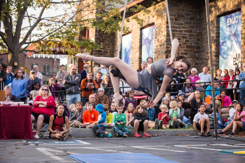 photo of Katie Schmidt, NECCA Coach, performing on dance trapeze