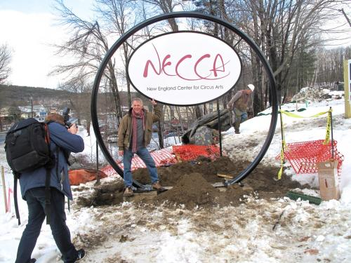 photo of the NECCA sign being raised at the new site