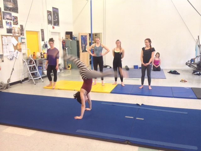 photo of a ProTrack Program student doing a front walkover in acrobatics class