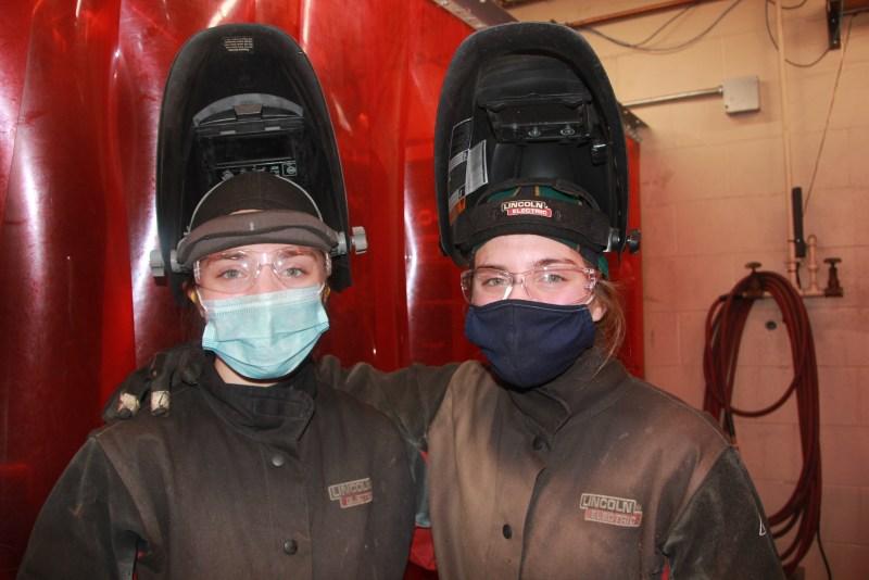 twin girl welders