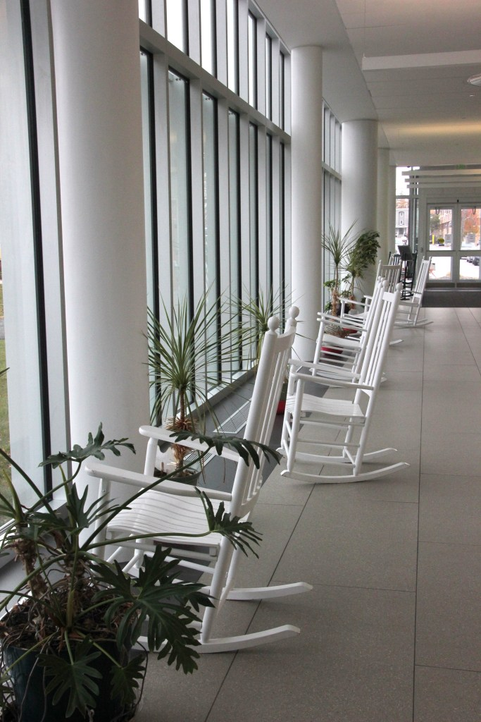 white rocking chairs by window