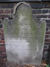 [Probable] headstone of Hannah Jacobs widow of B. Jacobs. Died August 20, 1825. Heavily weathered Hebrew and English inscription