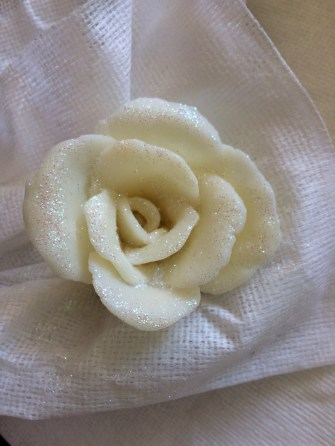 first-rose-bloom-with-glitter