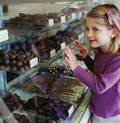 Kid admiring chocolate