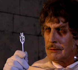 Vincent Price as Dr. Anton Phibes