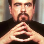 Hugo Drax with fingers steepled from Moonraker