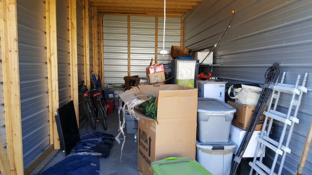 a storage garage full of items waiting to be auctioned off