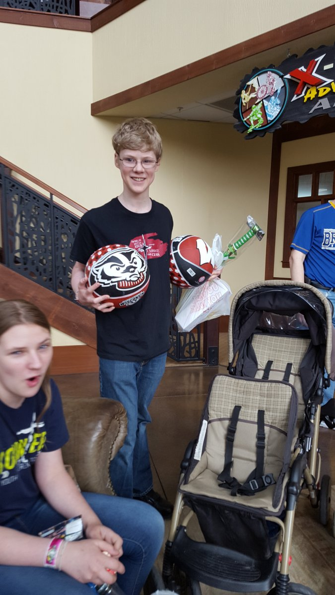 teens with their score of balls and prizes from the arcade on vacation