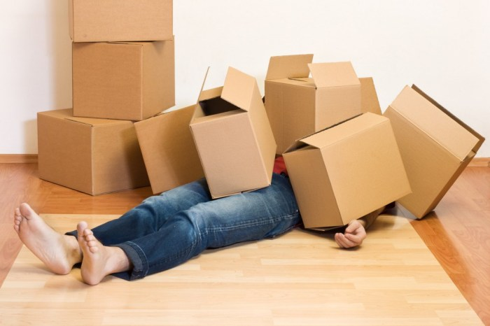 moving boxes have fallen on a person laying on the floor don't attempt to move alone