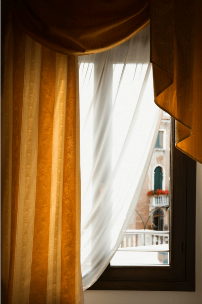 drapes partially covering window Perfect Ways to Add Some Elegance to Your Home's Interior