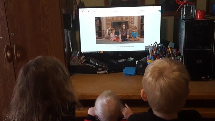 three little children watching a music video from SchoolhouseTeachers.com video library