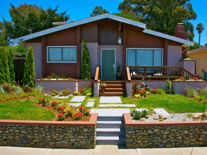 front yard of one story brown house green door garden landscape stairs sidewalk Improve The Curb Appeal Of Your Home