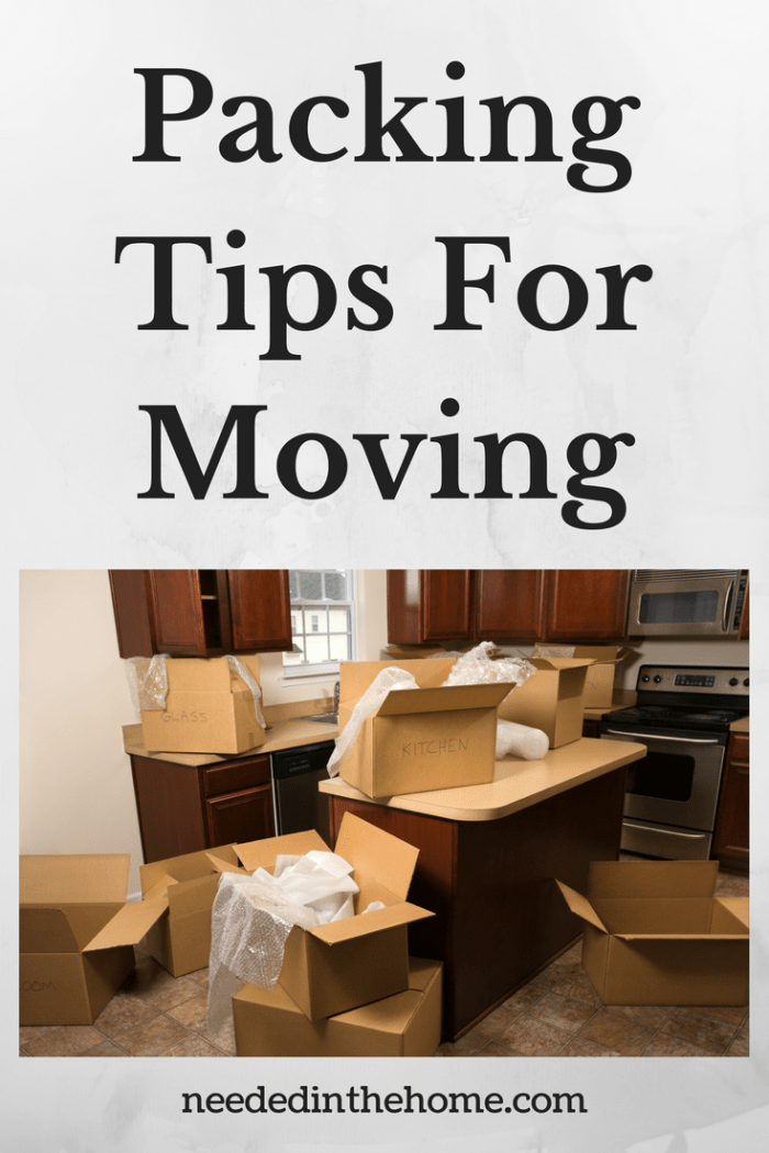 cardboard boxes and packing materials in kitchen on counters and floor packing tips for moving neededinthehome.com
