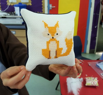 Fox cross-stitch pillow made by a Stitch Club student