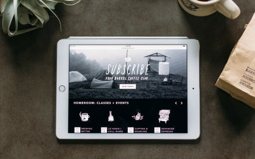 Home page of the Four Barrel Coffee responsive website shown on an iPad.