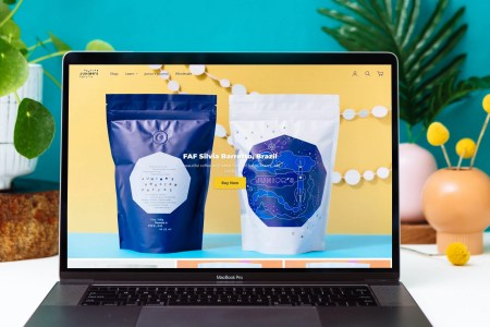 Home page of Junior's Roasted Coffee website featuring vibrant photography