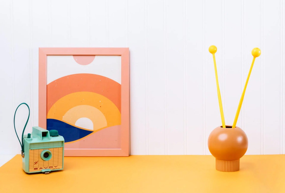 Playful lifestyle with a camera, poster and mallets