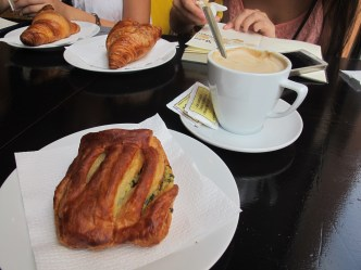 Spinach croissant and coffee, only 1,60 euros total! Barcelona is so much cheaper than Paris.