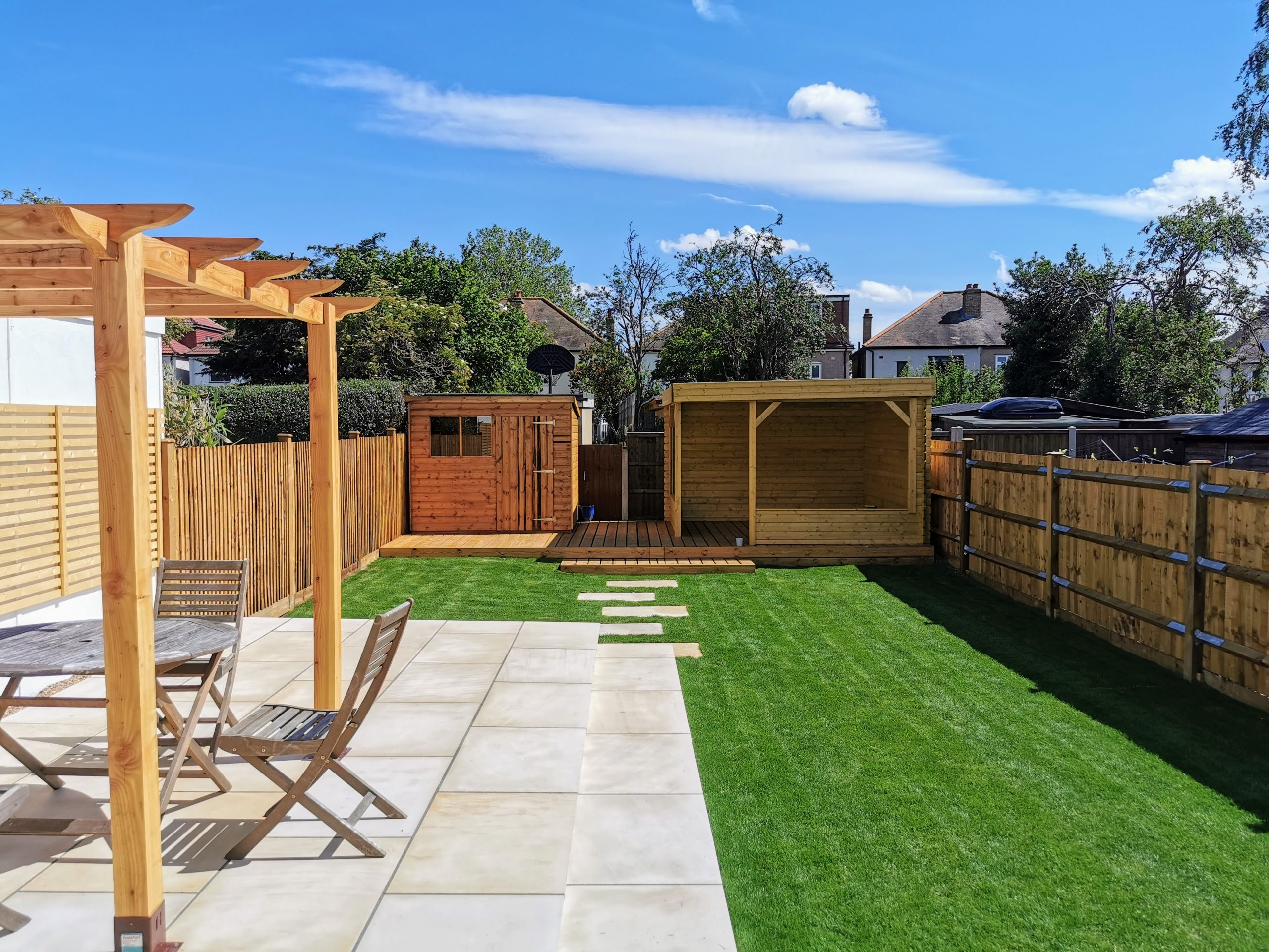 full landscape garden with patio area and pergola, summerhouse and decking with Fencing