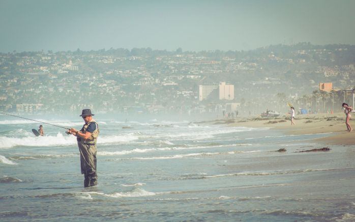Man Fishing Fisherman Hat Beach Waves Sea