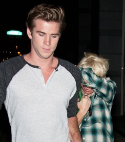 Miley Cyrus hides her new haircut as she goes out with Liam Hemsworth in Philadelphia, PA