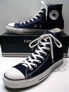 A_classic_Black_pair_of_Converse_All_Stars_resting_on_the_Black_&_White_Ed._Shoebox_(1998-2002)