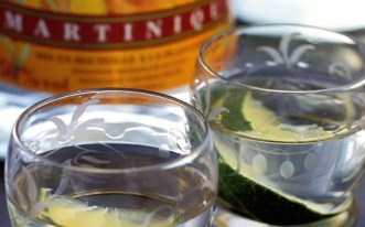 """French Caribbean - Ti Punch This simple mix of white rum, cane sugar and lime is usually served straight as an aperitif on the French Caribbean islands of Martinique and Guadeloupe. It is often served """"to taste"""": drinkers are presented with a glass of rum, a lime and some syrup to make it up as they wish."""