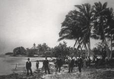 In this 1896 photo provided by HistoryMiami, people are seen along the banks of the Miami River at the groundbreaking of the Royal Palm Hotel in Miami.