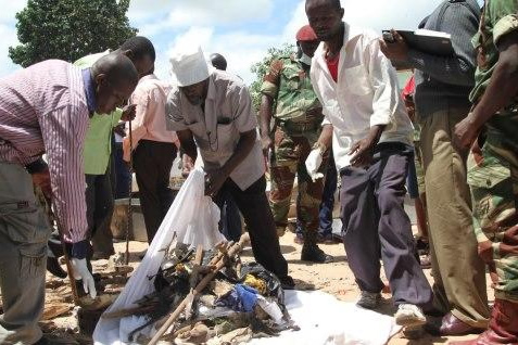 Photo of the father of the deceased Chitungwiza n'anga seen collecting his son's tools of the trade. (Pic by NewsDay)