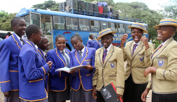 Ordinary Level students from Bradley High School have time to read and chat while waiting to board the bus back to school from Harare yesterday - Picture by Kudakwashe Hunda