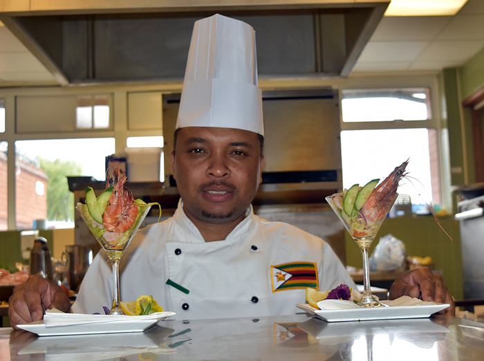 Zimbabwean chef currently based in London Chef Genias Mupfayi says being a chef is family legacy, as he poses with Prawn Cocktail.