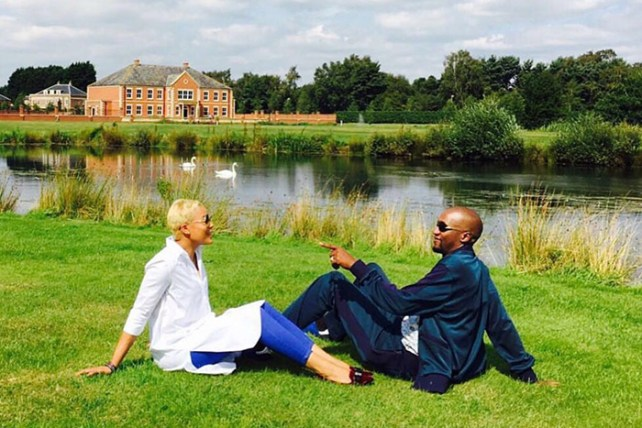 Prominent preacher Uebert Angel and wife Beverly share a loving moment in their 13 acre private garden at their massive mansion home in the United Kingdom.