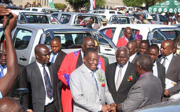 President Emmerson Mnangagwa handing over Isuzu twin cabs to chiefs