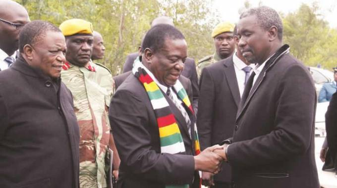 President Mnangagwa consoles Mr Kudakwashe Tagwirei while flanked by Vice President Constantino Chiwenga before the burial of the businessman's father, Sekuru Phineas Tagwirei, in Shurugwi yesterday. - (Picture by John Manzongo)