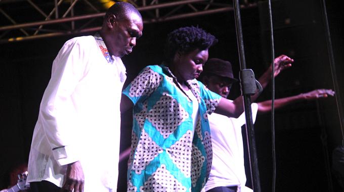 Picky Kasamba (left) and Selmor Mtukudzi on stage at Tuku Memorial concert