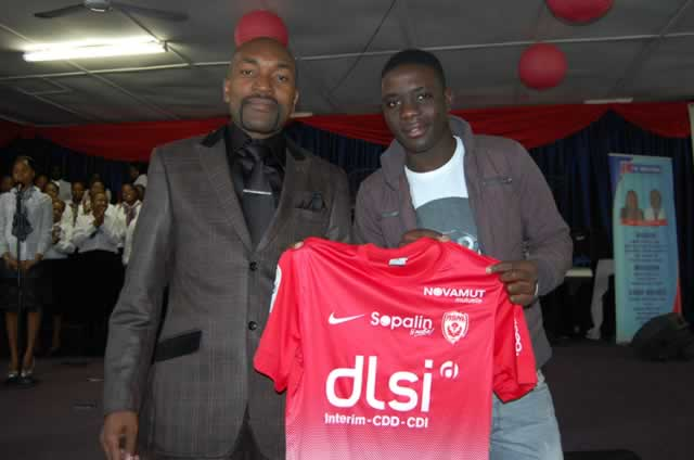 Then French side AS Nancy midfielder Marvellous Nakamba presenting his club jersey to Prophet Blessing Chiza at Eagle Life Ministries during a Sunday service in 2014