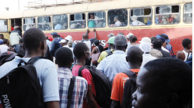 Commuters crowd into a Zupco bus in Bulawayo yesterday