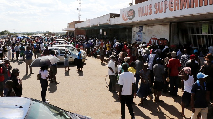 There was pushing and shoving at a long winding queue for mealie meal at Nketa shopping Centre yesterday.