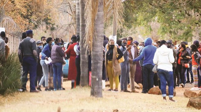 Part of a large crowd gathered at a Borrowdale, Harare, premise in August 2020 to engage in pyramid scheme activities before they were rounded up by the police for violating lockdown regulations