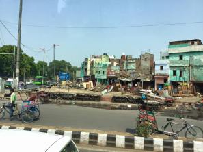 Passing homes/businesses on the way to the heart of Delhi