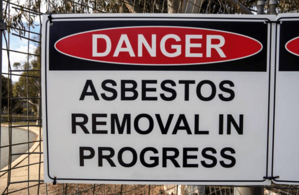 Danger sign, reading asbestos removal in progress