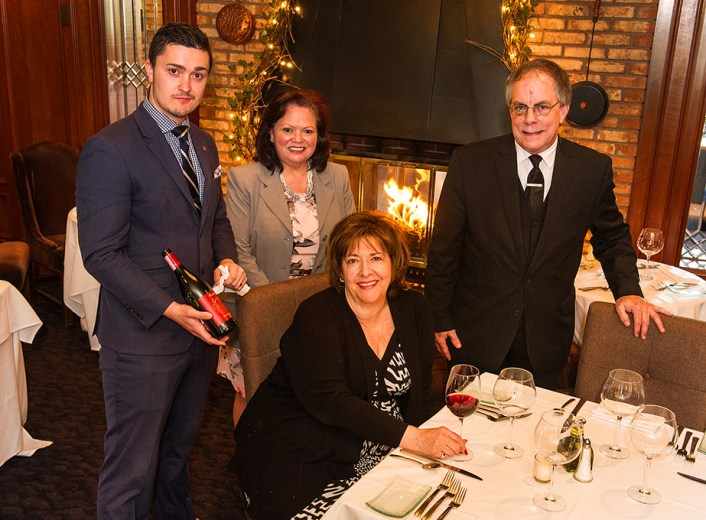 Members of the Cafe Cortina family: sommelier Tomaso Cupp, head event planner Tammy Chavez, head wait staff Timothy Bailey and Rina Tonon, seated, owner of Cafe Cortina. Photo by Jerry Zolynsky.