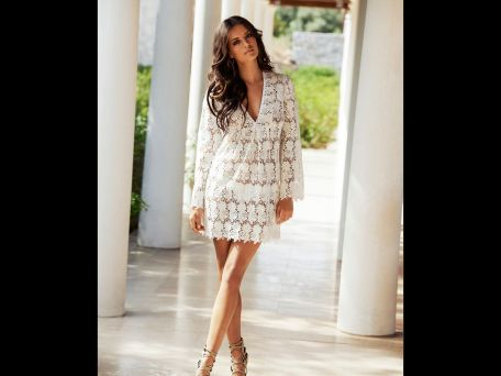 Melissa Odabash white knit cover-up, $390, available at SHE in Bloomfield Hills.