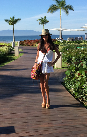 Sharon's personal picks include a Caracas bikini in rust ($230) , a Melissa Odabash Karen dress in white ($198) and JADEtribe bag.