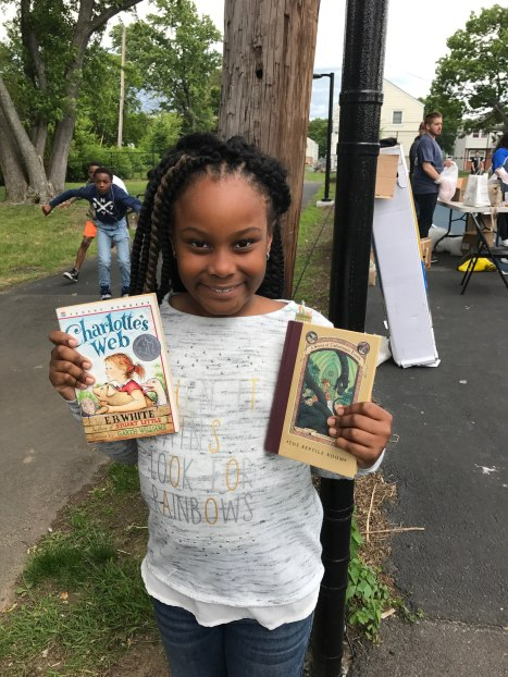 Giuliannah Dormevil (age 8) proudly displays two of her book choices.