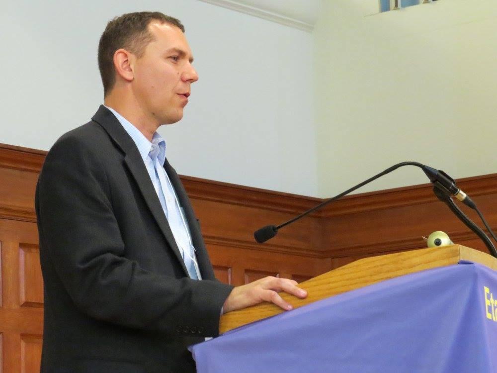 Neil speaking