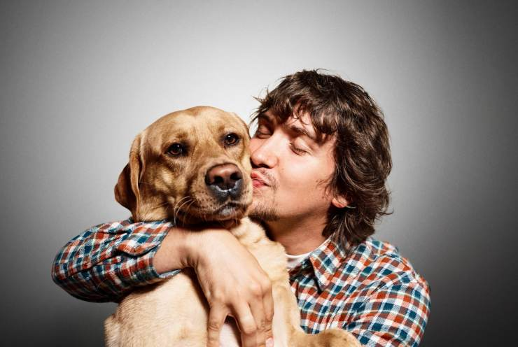clear uncompressed image of man kissing dog