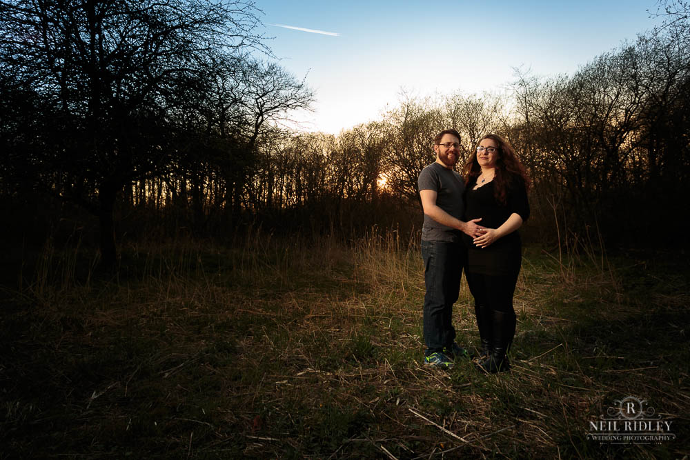 Lancashire Pre Wedding Shoot at Scorton Lake, a young couple pose in a forest clearing