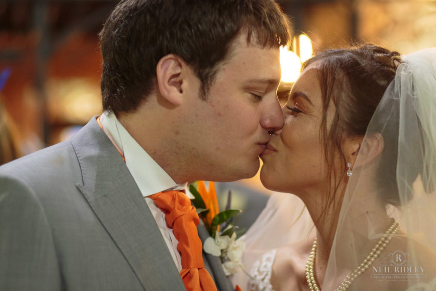 Bride and Groom Kiss at Altar in St Thomas Church in St Annes-on-Sea