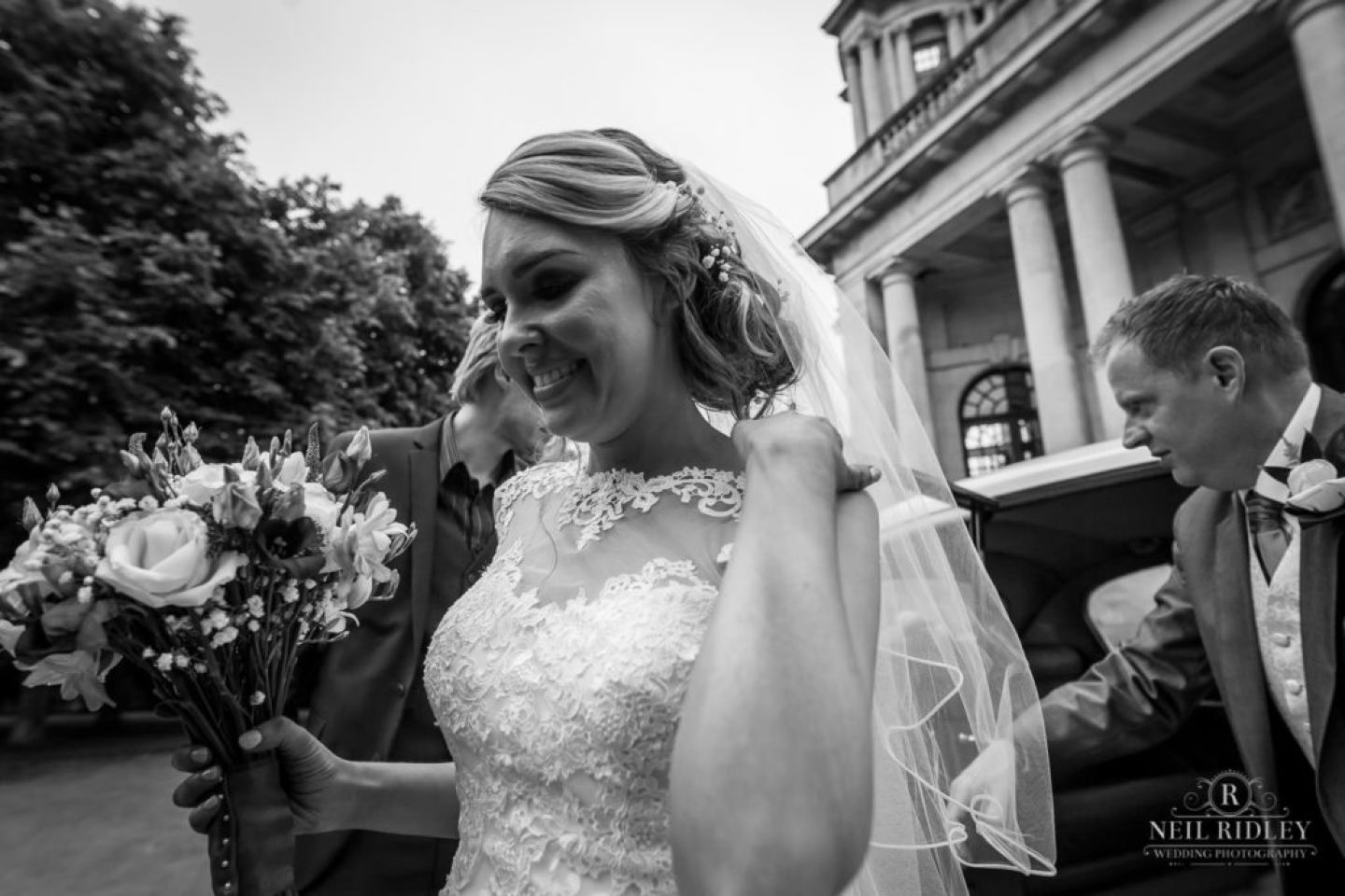 Lancaster Wedding Photographer - Black and white image of Bride arriving at Ashton Memorial Lancaster